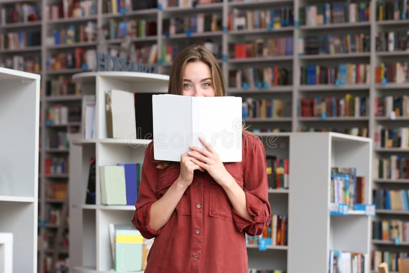 Young pretty woman with book royalty free stock image