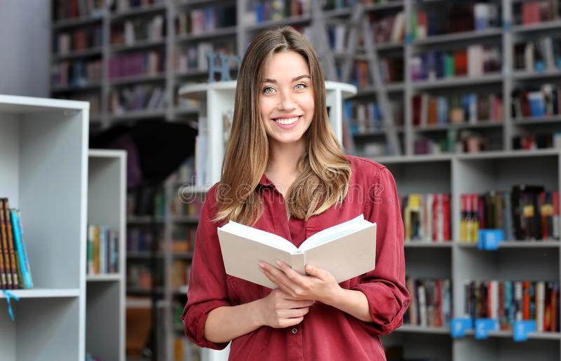 Young pretty woman with book in royalty free stock images