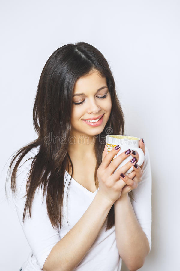 Young pretty woman drinking coffee or tea . Relaxing girl . Woman drinking coffee in the morning at home lifestyle. Studio royalty free stock photos