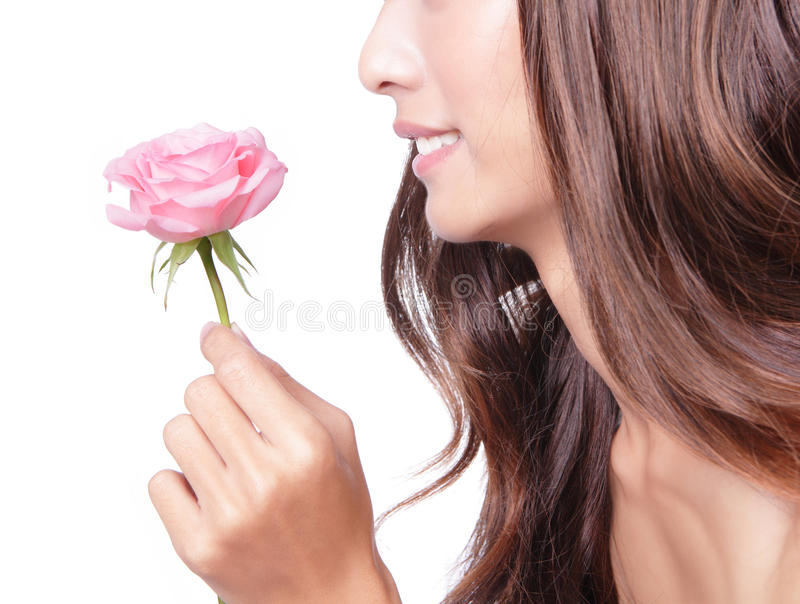 Download Young Pretty Woman Enjoying Smell Pink Rose Stock Photo - Image: 23988372