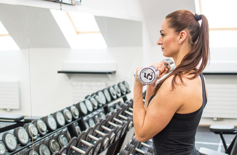 Young pretty woman in fitness stock photos