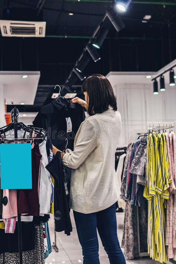 Young pretty woman in the fashion store. Shopping concept. stock photo