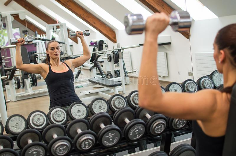Young pretty woman in fitness royalty free stock photography