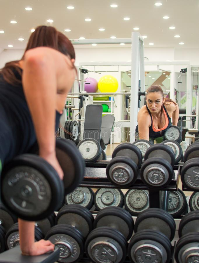 Young pretty woman in fitness stock photo