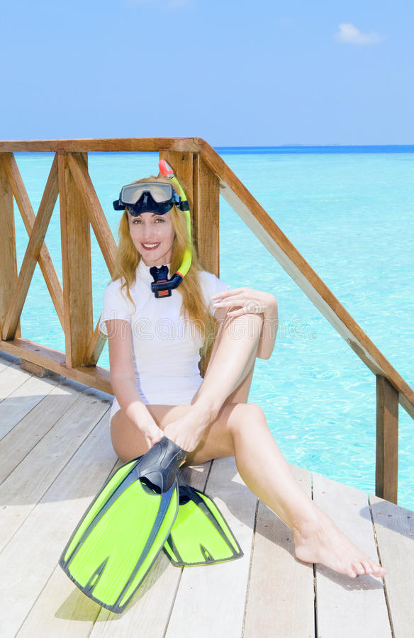 Young pretty woman with flippers, mask and tube at royalty free stock photos