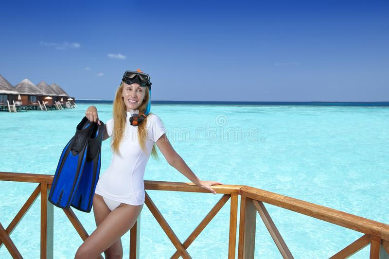 Young pretty woman with flippers, mask and tube. Maldives royalty free stock photos