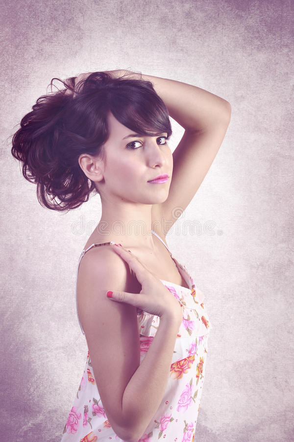 Young pretty woman in floral dress royalty free stock photography