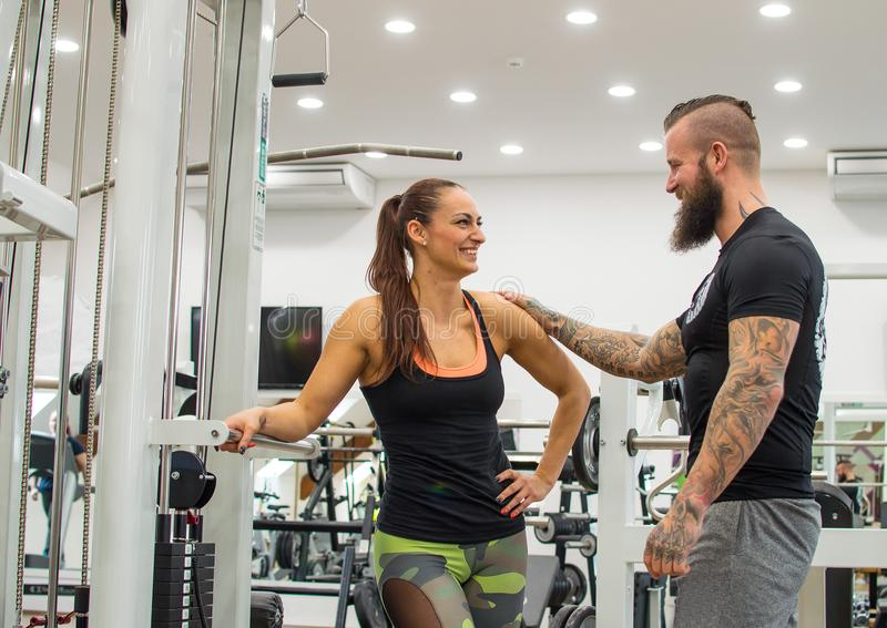 Young pretty woman and hipster in fitness royalty free stock image