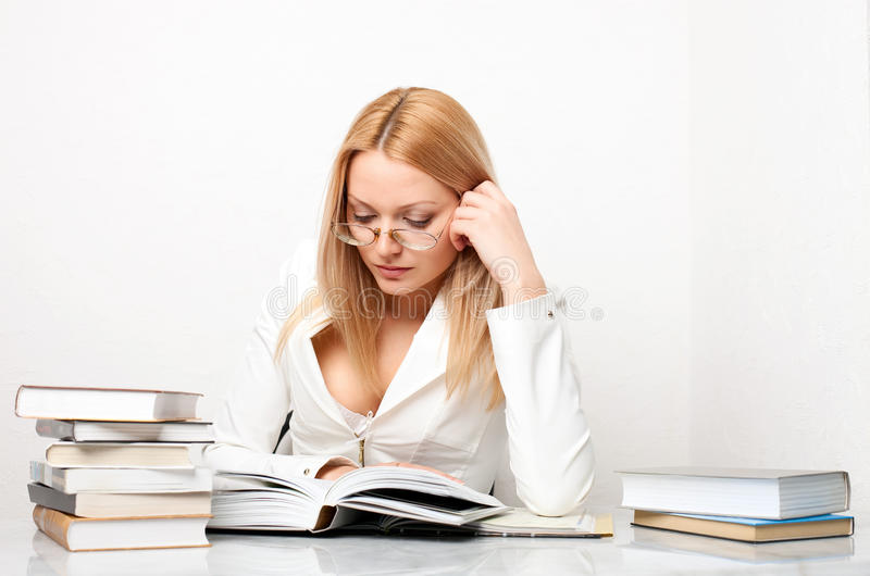 Young Pretty Woman Learning At Table With Books Royalty Free Stock Image