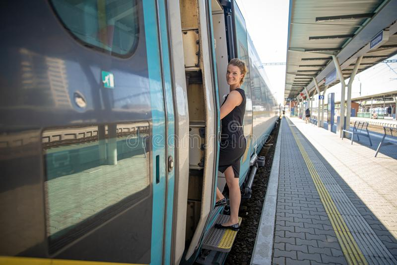 young handsome woman on a train leaves for a business trip to see a business partner stock photos