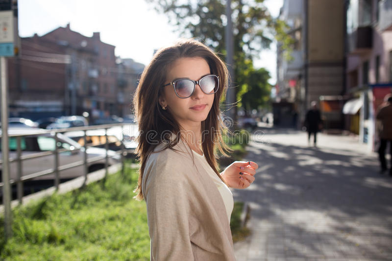 Young pretty woman outdoor fashion portrait. Beautiful girl casual dress and sunglasses royalty free stock photography