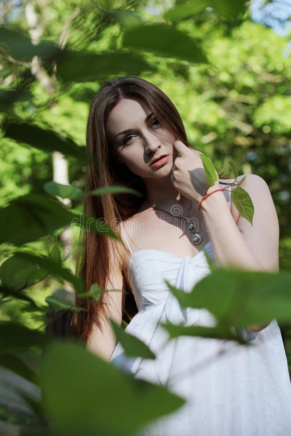 Young pretty woman in park royalty free stock photo