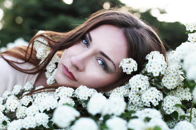 Young pretty woman in park stock photo