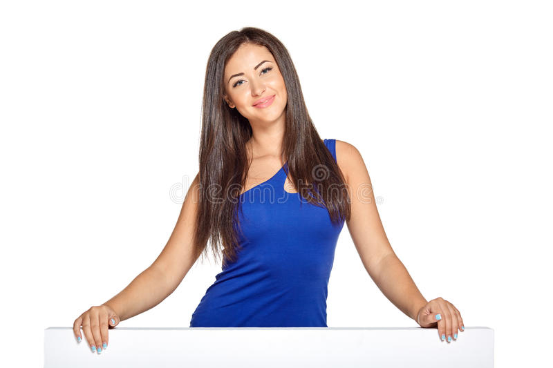 Young pretty woman peeking out from behind the stock photography