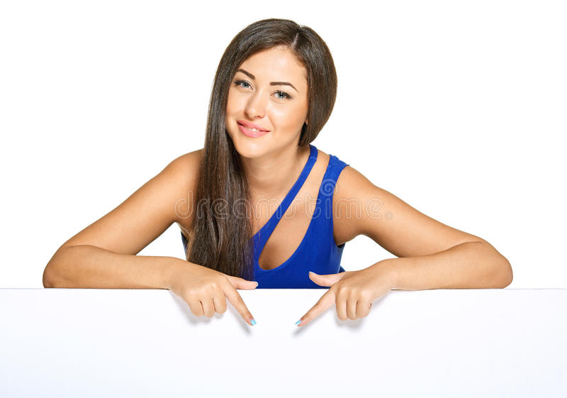 Young pretty woman peeking out from behind the royalty free stock photos