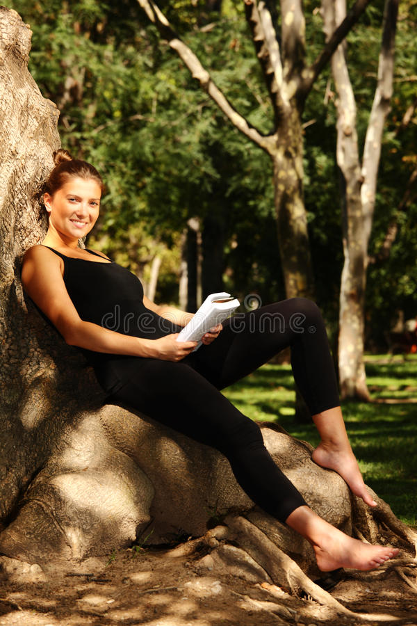 Free Young Pretty Woman Reading In The Park Royalty Free Stock Photography - 16281197