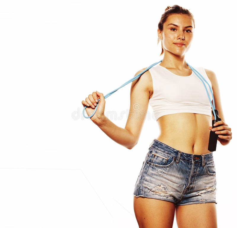 Young pretty woman with skipping rope isolated on white. Watching shape royalty free stock photo