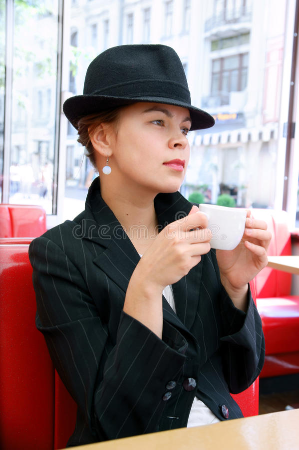 Young pretty woman in street cafe stock image