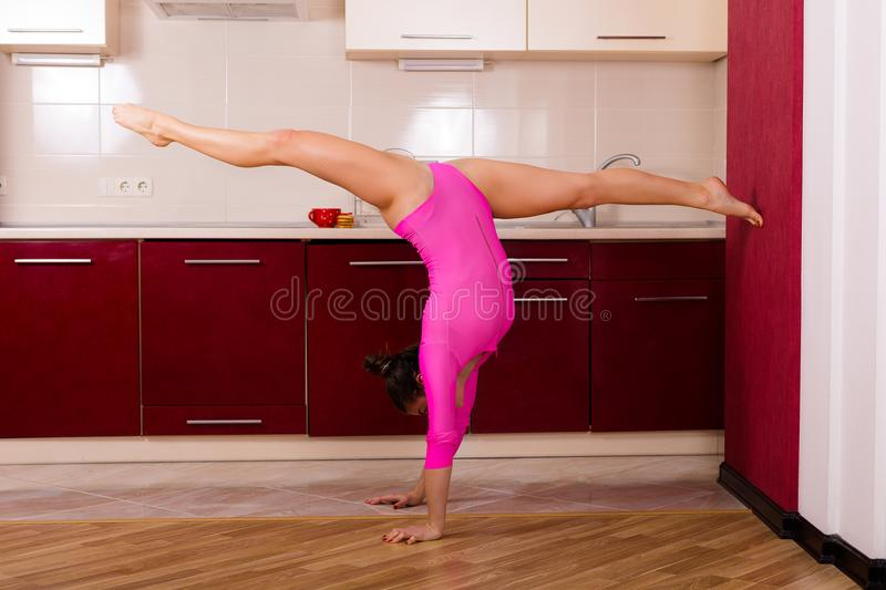 Woman stretching at home stock image