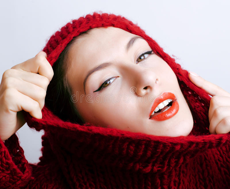 Young pretty woman in sweater and scarf all over her face, lifestyle people winter concept. Young pretty brunette woman in sweater and scarf all over her face stock photography