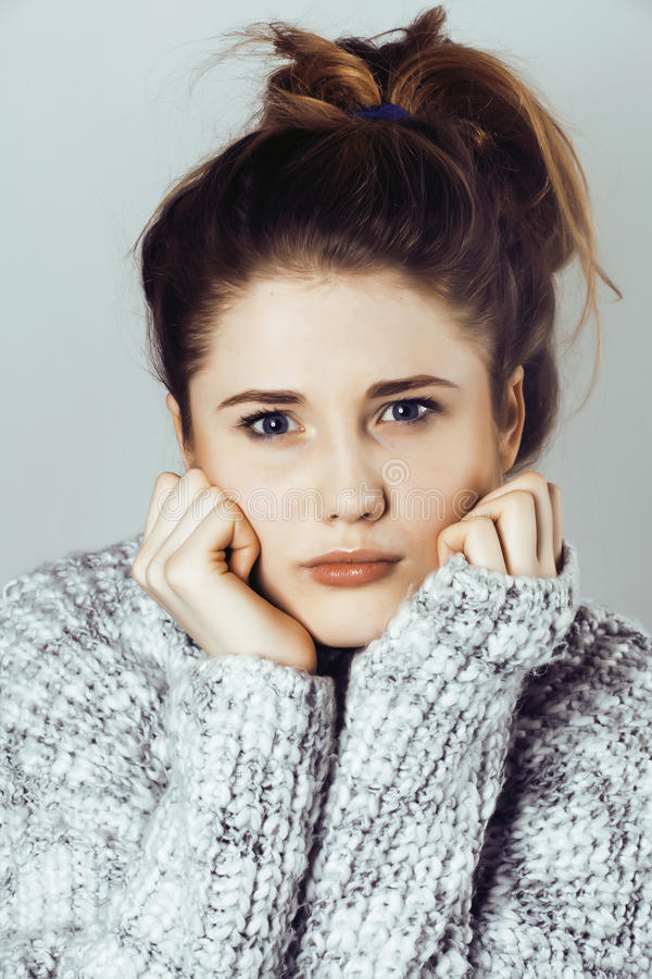 Young pretty woman in sweater and scarf all over her face, winte. R cold close up, lifestyle real people concept royalty free stock image