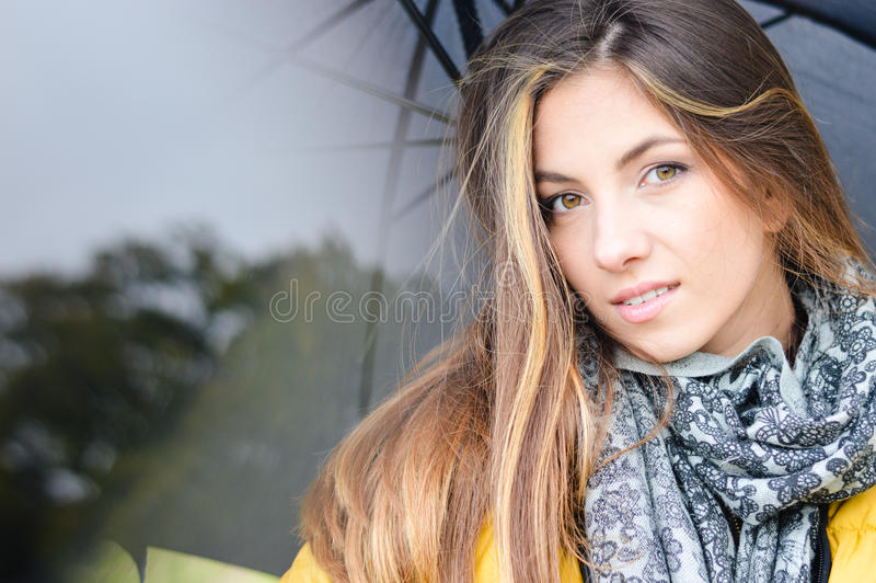 Young pretty woman with umbrella stock image