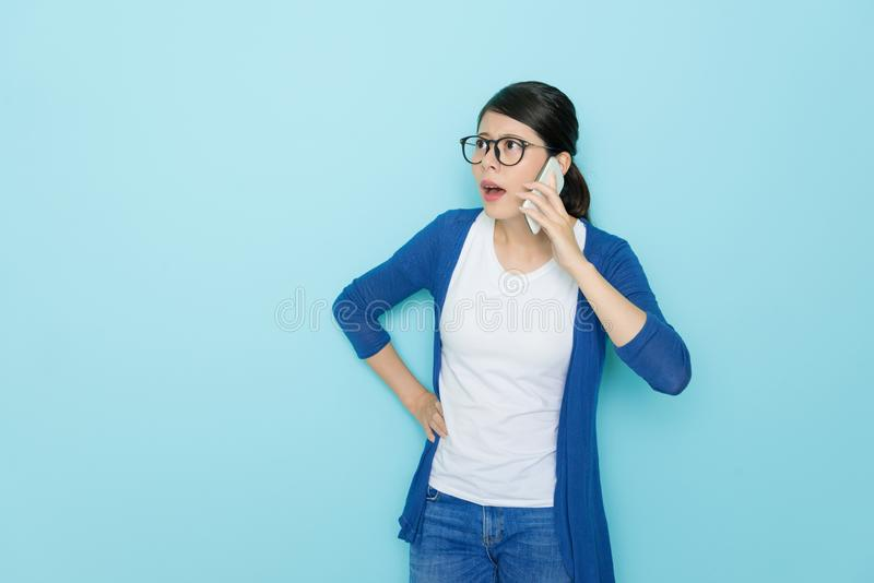 Young pretty woman using mobile cell phone stock image