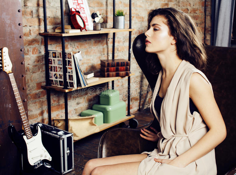 Young pretty woman waiting alone in modern loft studio, fashion musician concept, lifestyle people. Close up stock images