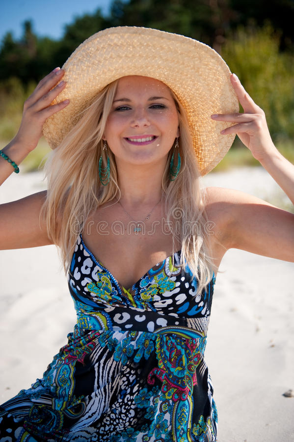 Free Young Pretty Woman With Hat Relaxing On The Beach Stock Photo - 12411420