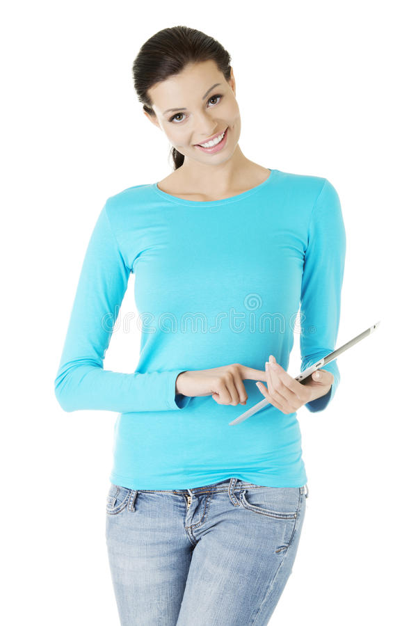 Download Young Pretty Woman Working On Tablet Computer Stock Photo - Image: 27983472
