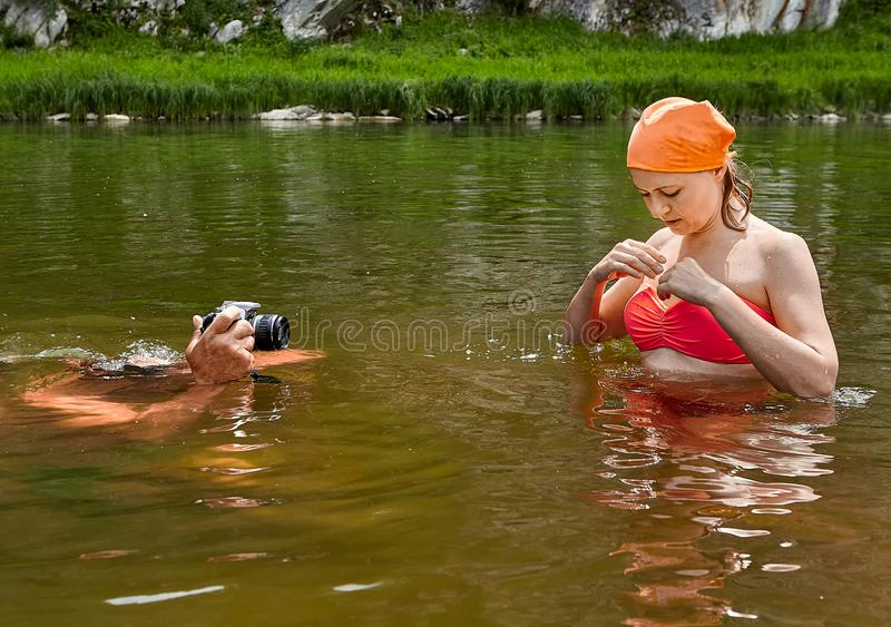 Taking photos of woman in river royalty free stock images