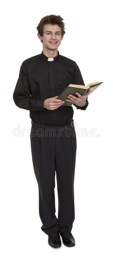 Young Priest Holding Bible royalty free stock image