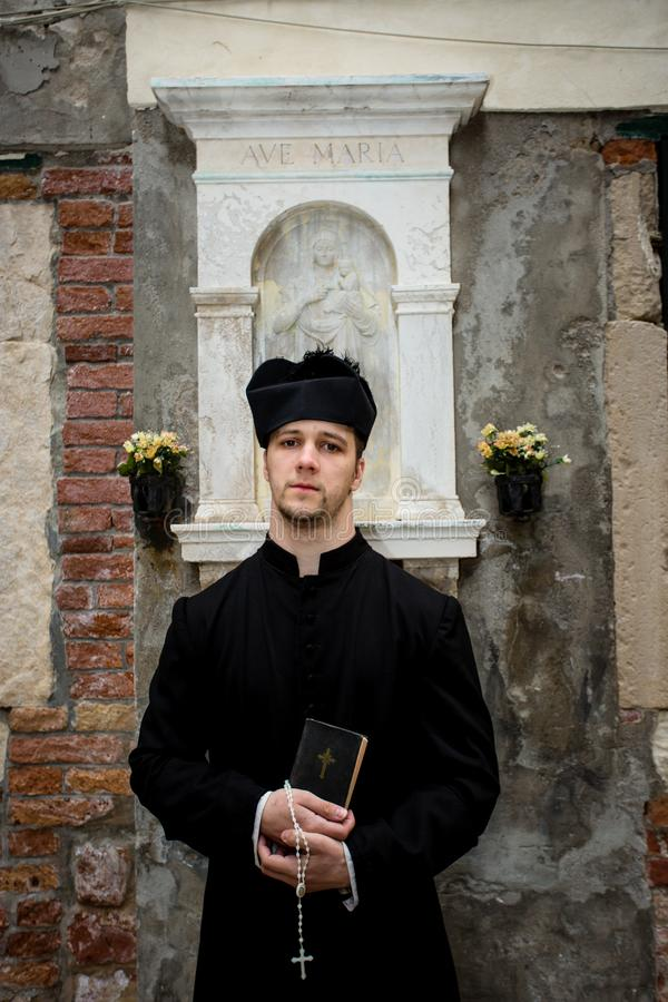 Young priest in venice stock images