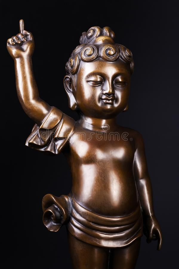 Young prince Siddhartha Gautama bronze statue. royalty free stock photography