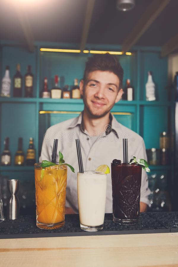 Bartender offers alcoholic cocktails in bar stock photo