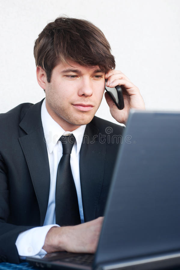 Young professional businessman on laptop stock photos