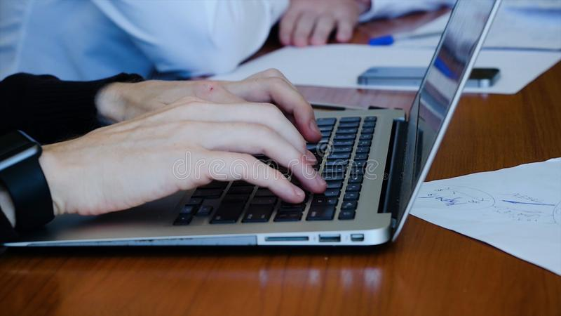 Download Young Professional Businessman Wearing Black Turtleneck And Using Modern Laptop, Close-up Of Male Hands Typing On Stock Image - Image of laptop, professional: 103513941