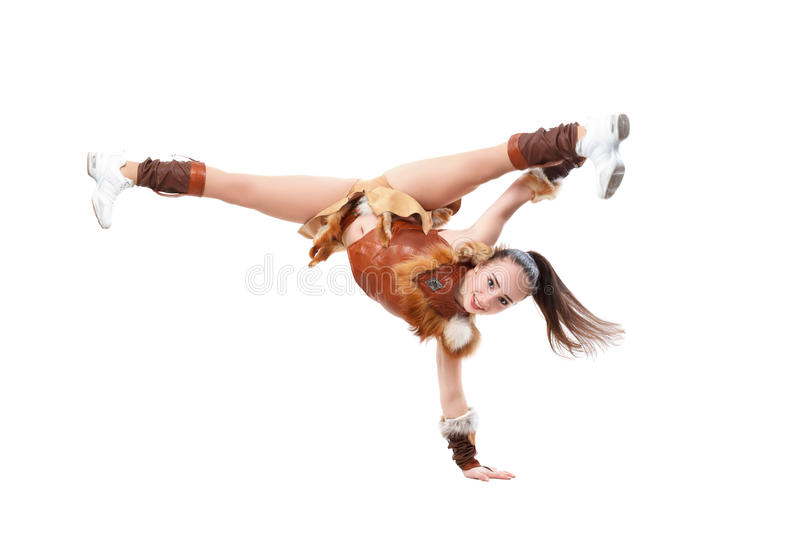 Young professional cheerleader dressed in a warrior costume standing on one hand. royalty free stock photos