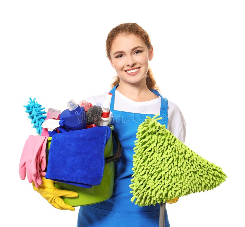 Young professional with cleaning supplies and mop, isolated. On white stock photos