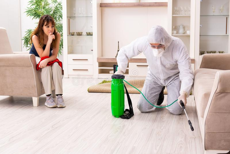 The young professional contractor doing pest control at flat. Young professional contractor doing pest control at flat stock images