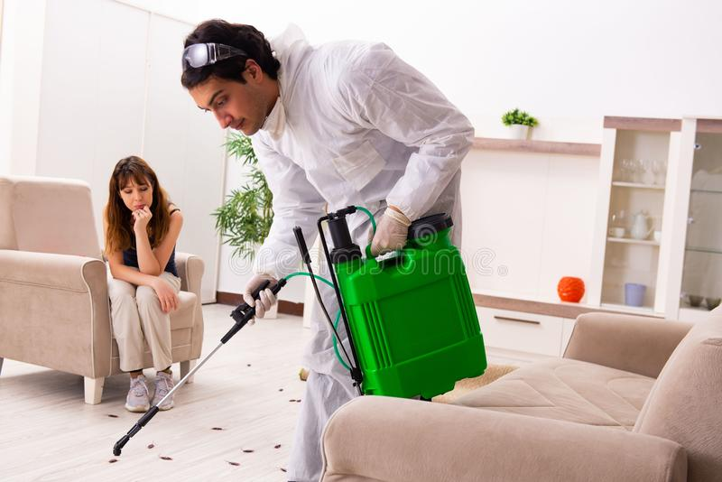 The young professional contractor doing pest control at flat royalty free stock photo