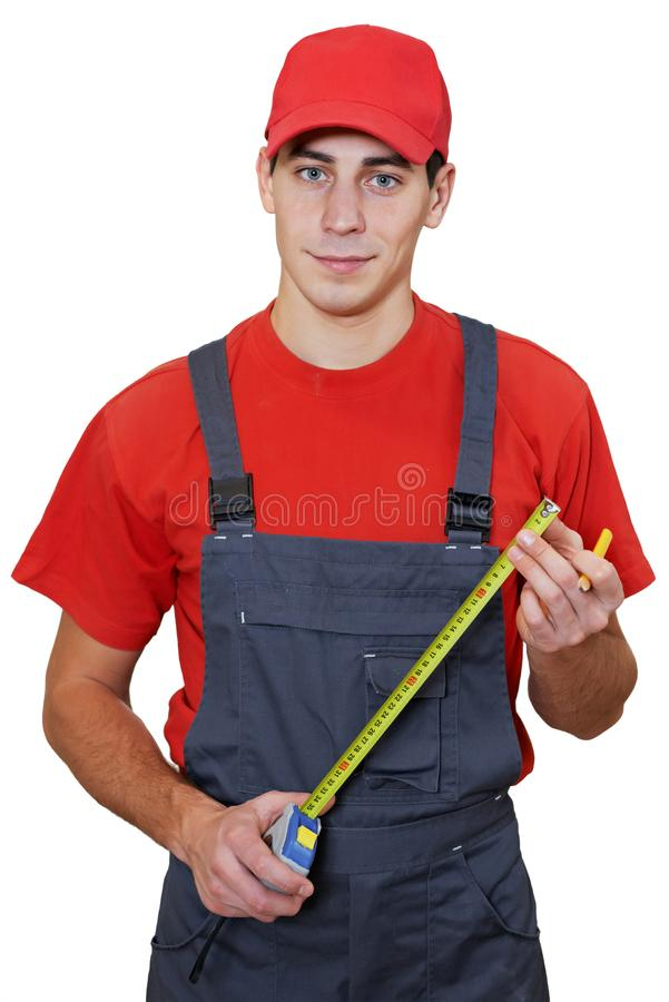Handyman worker with measuring tape royalty free stock photography