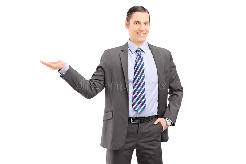 Download Young Professional Man In A Suit Gesturing With His Hand Stock Photo - Image: 30128270