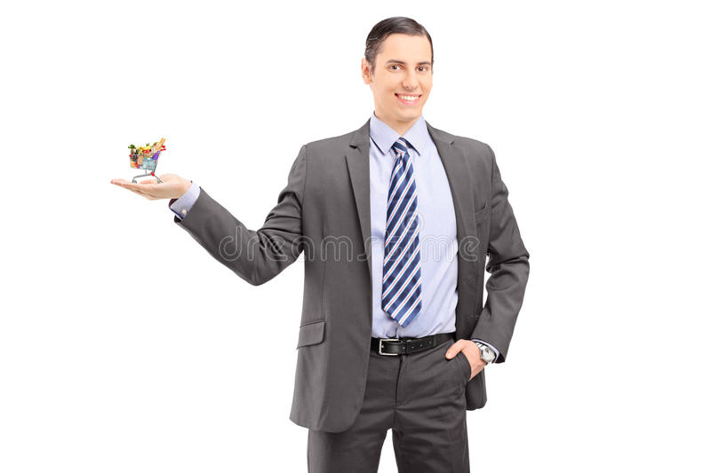Young professional man in a suit holding a small shopping for How to be a professional shopper