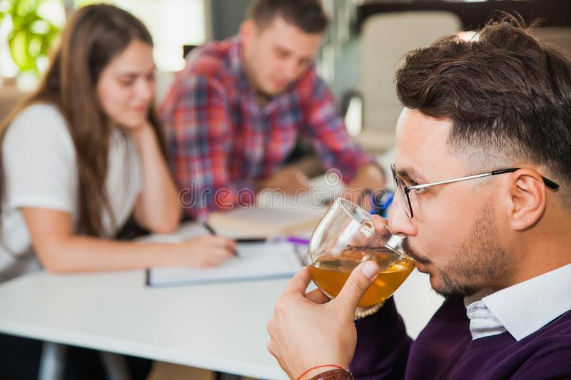 Young professional man drink tea have a break at business brainstorming royalty free stock photos