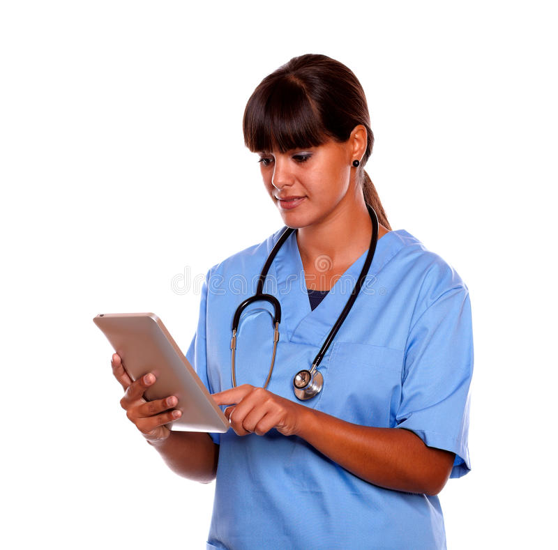 Young professional nurse using her tablet pc stock images