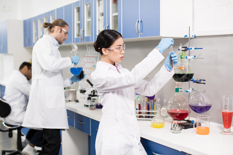 Young professional scientists making experiment in research laboratory stock image