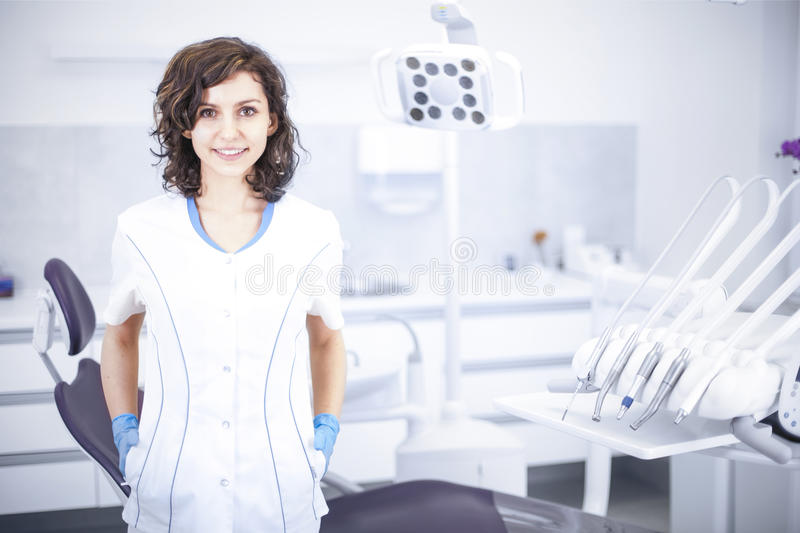Young professional woman dentist in the dental office royalty free stock image