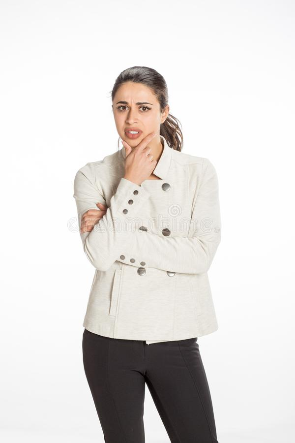 Young professional woman dressed for business with arms folded looking serious. Great concept for work, business or planning. royalty free stock image