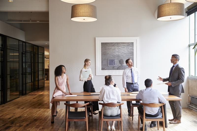 Young professionals around a table at a business meeting royalty free stock photo